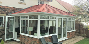 red Metrotile conservatory tiled roof using Guardian Warm Roof System