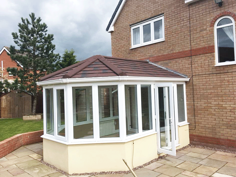 Burnt Umber tiled conservatory roof installed by Synergy in Cumbria