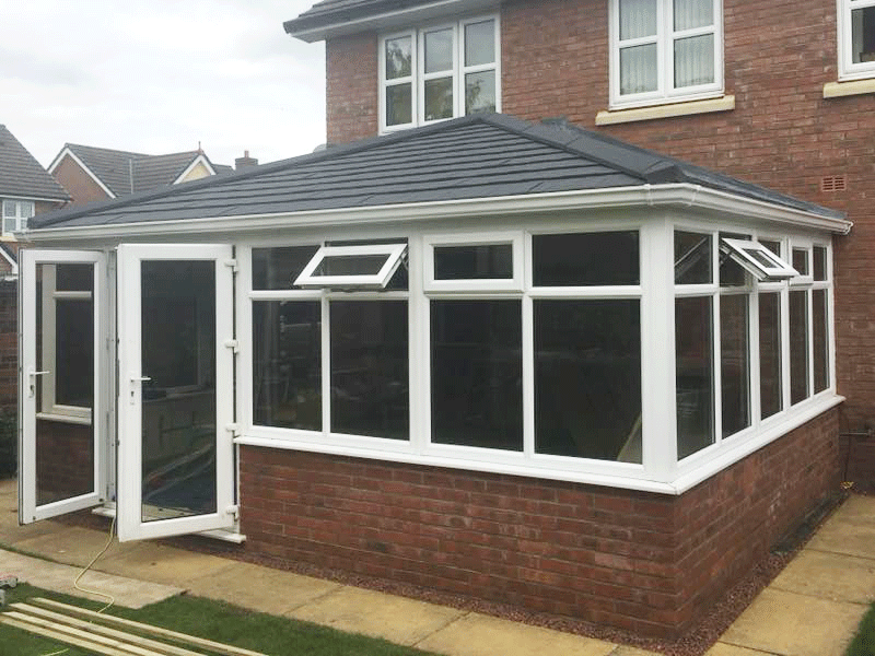 Double hipped Edwardian tiled conservatory roof installed by Synergy in Cumbria