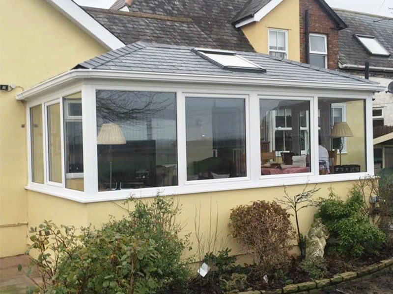 Double hipped Edwardian with box gutter tiled conservatory roof installed by Synergy in Carlisle