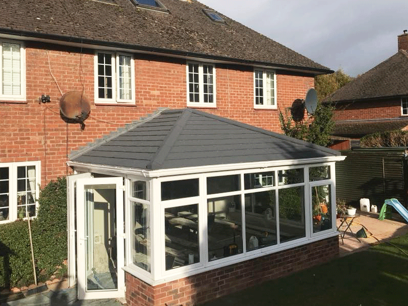 Edwardian tiled conservatory roof with charcoal metro tile installed by Synergy in Cumbria