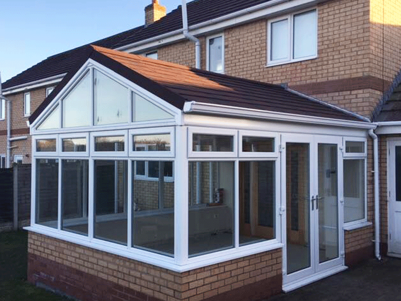 Gable fronted burnt umber metro tile, tiled conservatory roof installed in Carlisle