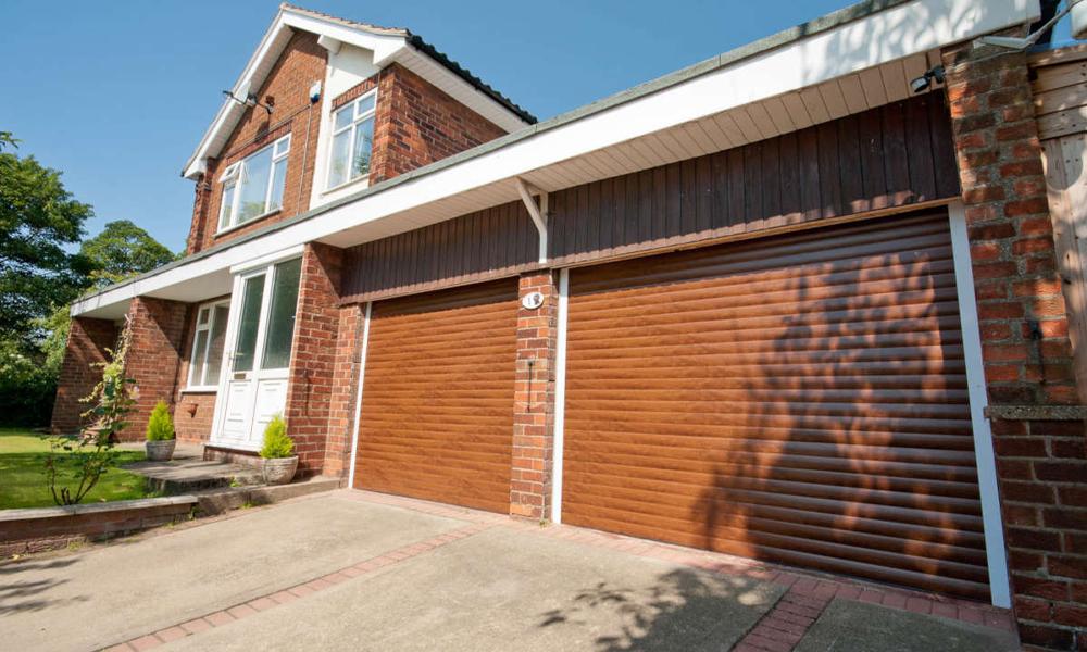 brown automated roller shutter garage door