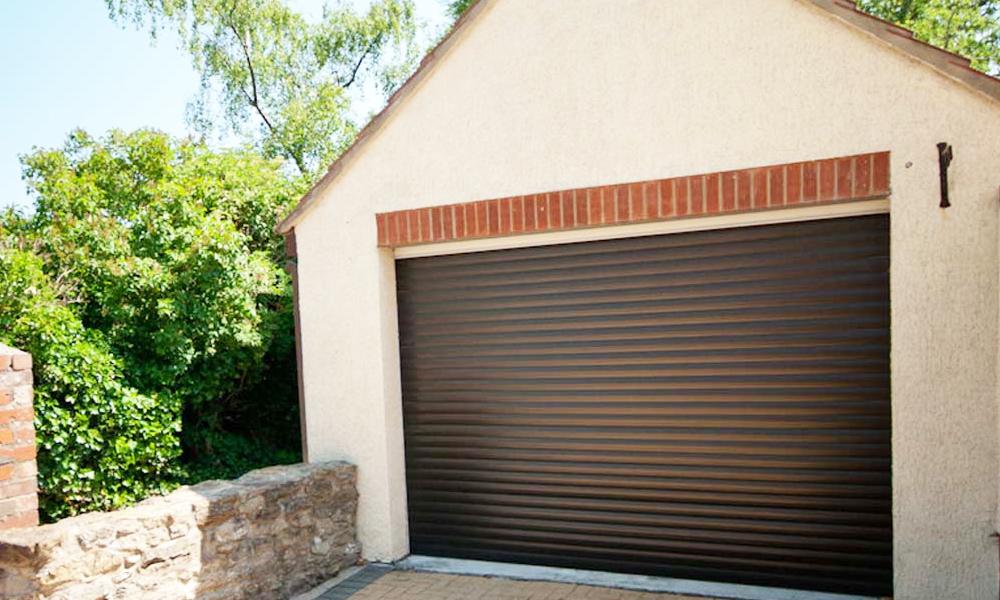 detached garage with roller shutter garage door